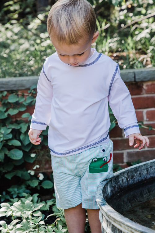 Boys Swim Trunks with Frog Appliqué on Model