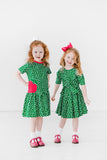 Green Short Sleeve Polka Dot Dress with Apple on Model with Pair