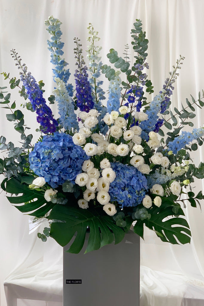 The Florté Florte | Blue Royalty, Congratulatory Stand, Blue Hydrangeas, White Roses, Purple Delphinium, Floral Arrangement, Best Florist Singapore, Best Flowers