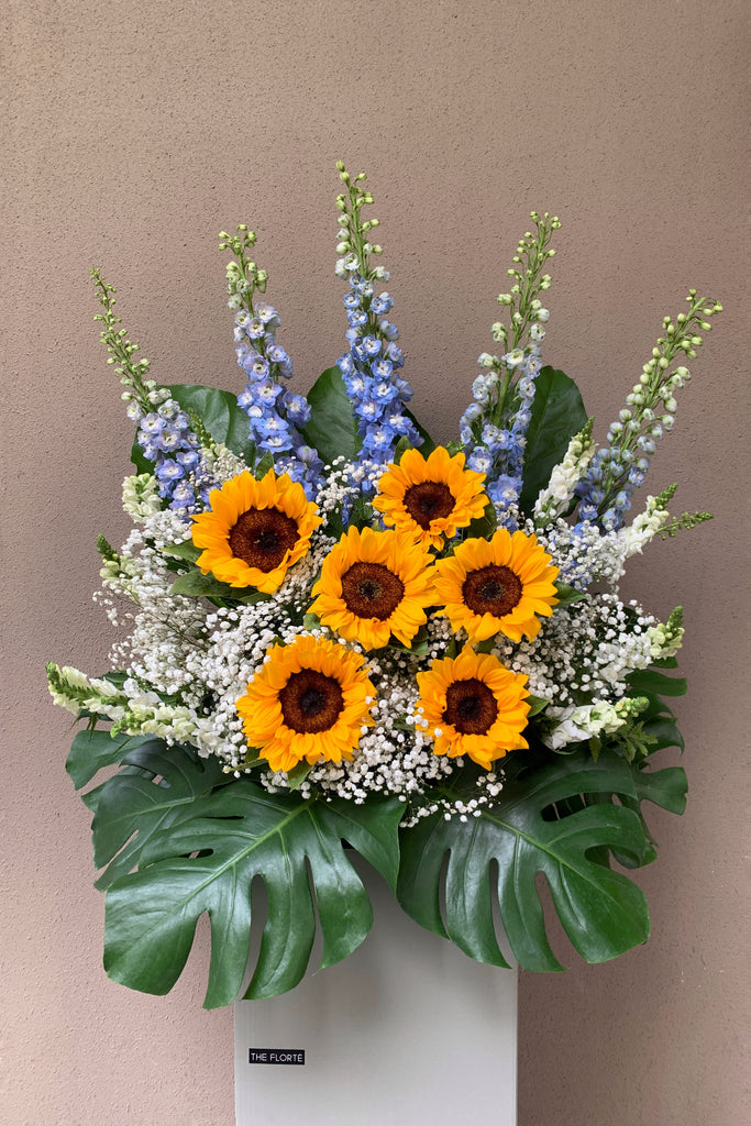The Florté | Congratulatory flowers, flowers, daily flowers, next day flowers, flower delivery, milestones, shop opening, achievements, congrats, flower stand, sunflowers, delphiniums, babys breath, prosperous, huat, wish someone all the best