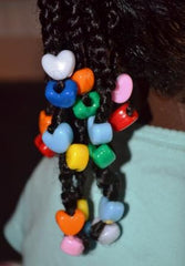 Heart shaped hair beads on braids