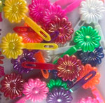 assorted color sunflower barrettes with sheen