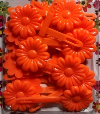 orange flower barrettes