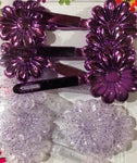 Purple and purple glitter snap barrettes