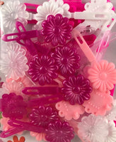 Shades of pink daisy barrettes