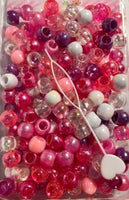 Pinks, purple,white and clear hair beads with sheen.