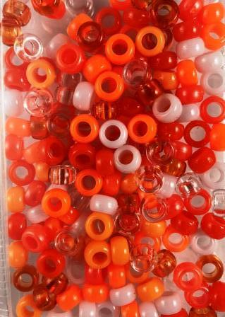 shades of orange, white, and clear hair beads