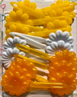 Yellow and white flower barrettes