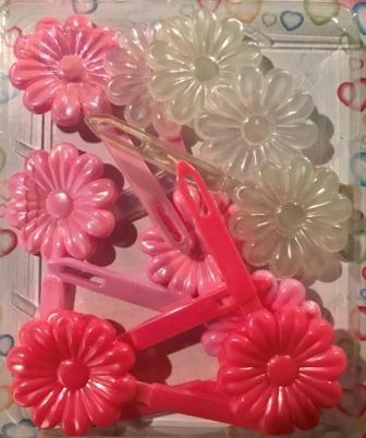 Shades of pink and clear flower barrettes with sheen