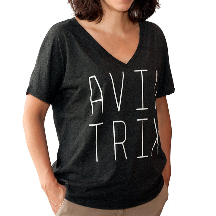 Bernoulli Apparel's Aviatrix vneck, a black triblend vneck with white lettering, This t-shirt pays tribute to the women aviation pioneers. Badass and heroic leaders of past, present, and future.