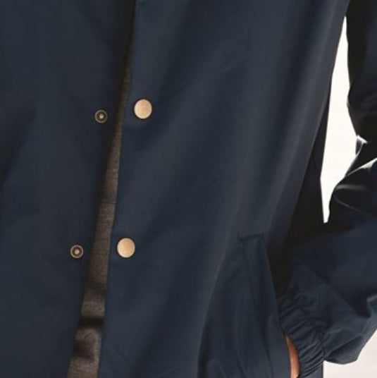 Close up view of Bernoulli Apparel Coaches Jacket highlighting the brass buttons.