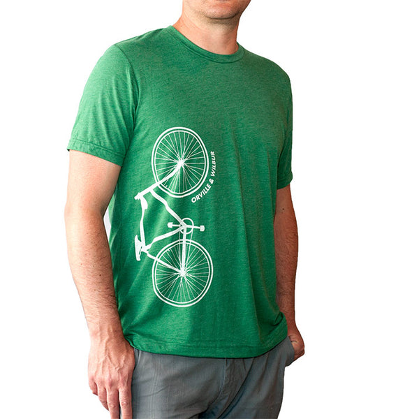Bernoulli Apparel's Wright Bros bike tshirt, a green triblend, with a white bicycle and Orville & Wilbur text screen printed on the front.