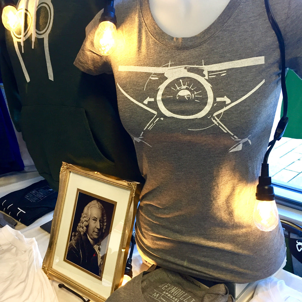 Our Gray women's cut, backcountry radial tshirt displayed at our pop-up shop.