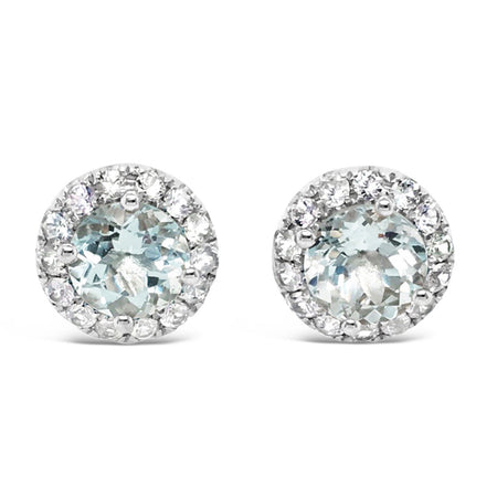 Brilliant cut Aquamarine earrings with halo white sapphire setting
