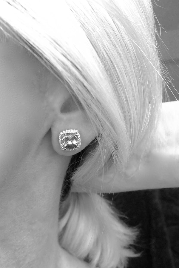Model with Barcelona light blue topaz in cushion cut and halo white sapphires
