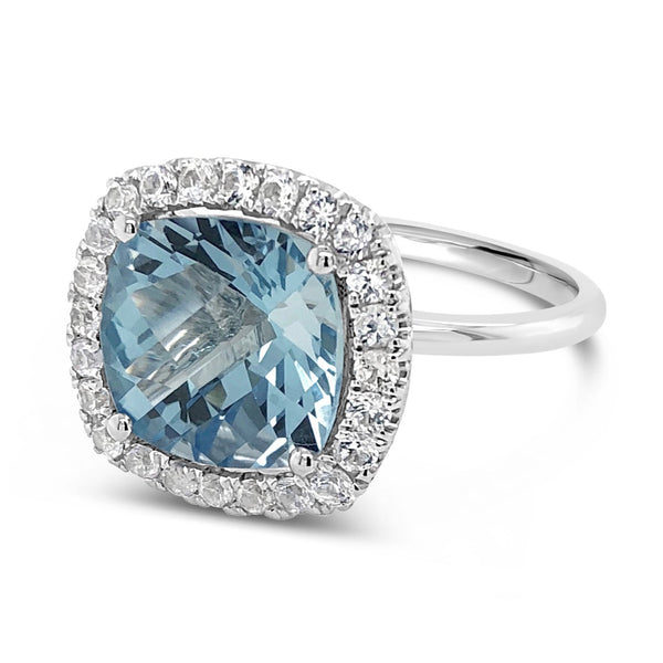 Blue topaz cocktail ring surrounded by a halo of 24 white sapphires