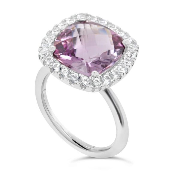 Amethyst cocktail ring surrounded by a halo of 24 white sapphires