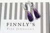 Palma purple amethyst briolette with white sapphires lying on Finnly's signature box