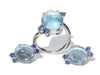 Pomellato style flower earrings and ring in blue topaz cabochon with blue sapphires