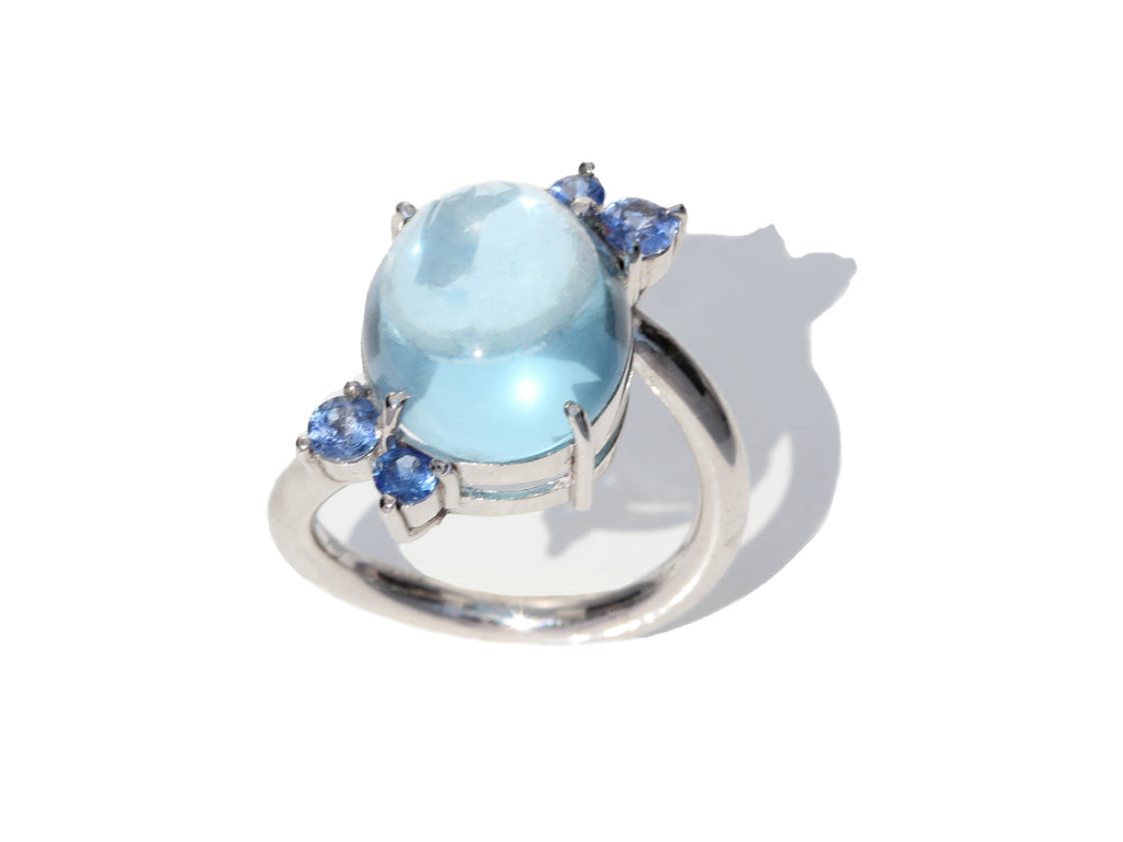 Natural Blue Topaz Cabochon and Blue Sapphires Flower Ring