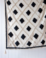 henley tufted throw