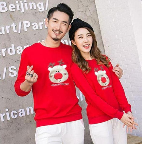 matching reindeer face christmas sweaters for couples