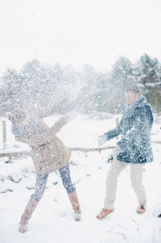 fun christmas traditions for couples snow fight