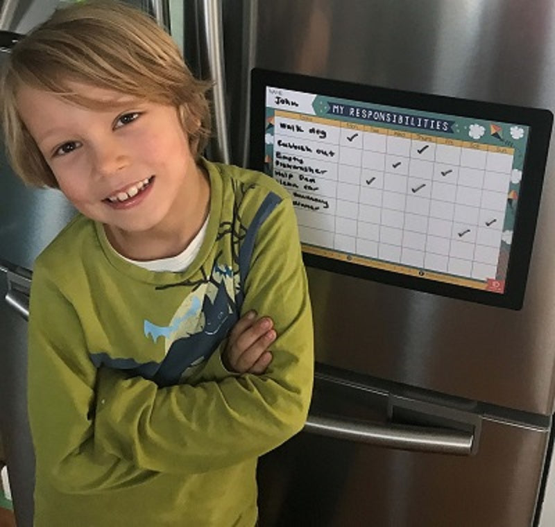 chore chart responsibility chart in magnetic frame on fridge with proud boy