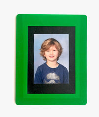 Small green magnetic frame for school or passport photographs