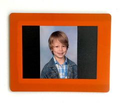 Small orange magnetic frame for school or passport photograph