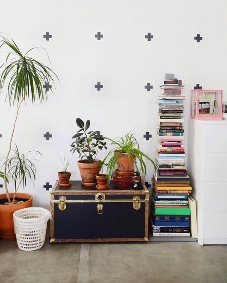 book shelf with planters