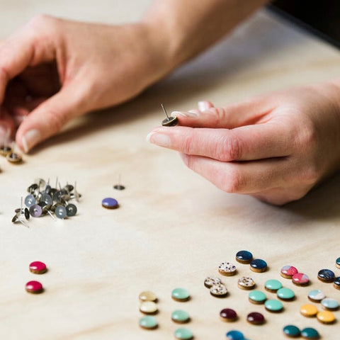 Earrings being made in a studio space