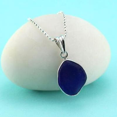 Sea glass pendant with sterling silver