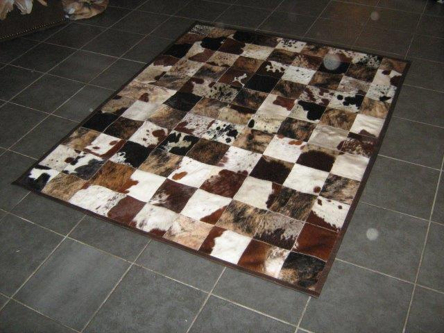 square stitched cow skin rug 15cm block size