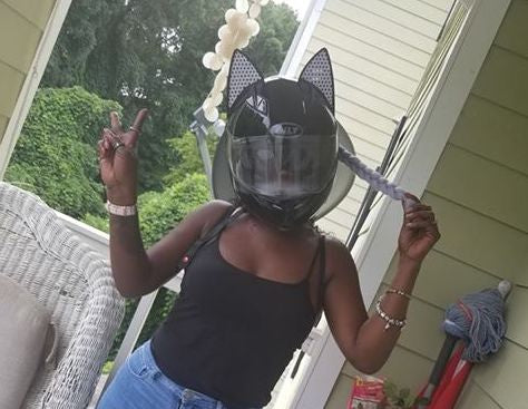 Felicia Strong in BILT Motorcycle helmet with Cat Ears and white decals installed with white ponytail