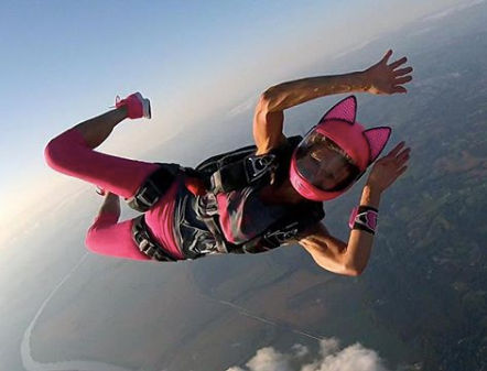 Liz in a Cookie G3 Helmet skydiving with the Cat Ear Upgrade accessory on at 150mph