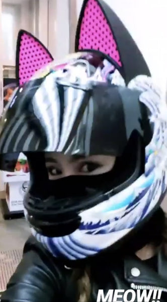 Vaune Phan in Arai Cat Ear Helmet and Pink reflective decals