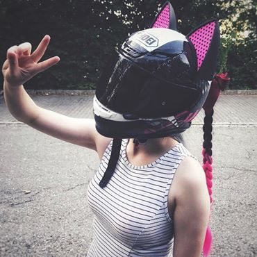 aileen keding ins a SHOEI Seduction Motorcycle Helmet with Cat Ears and Black and Pink Ponytail