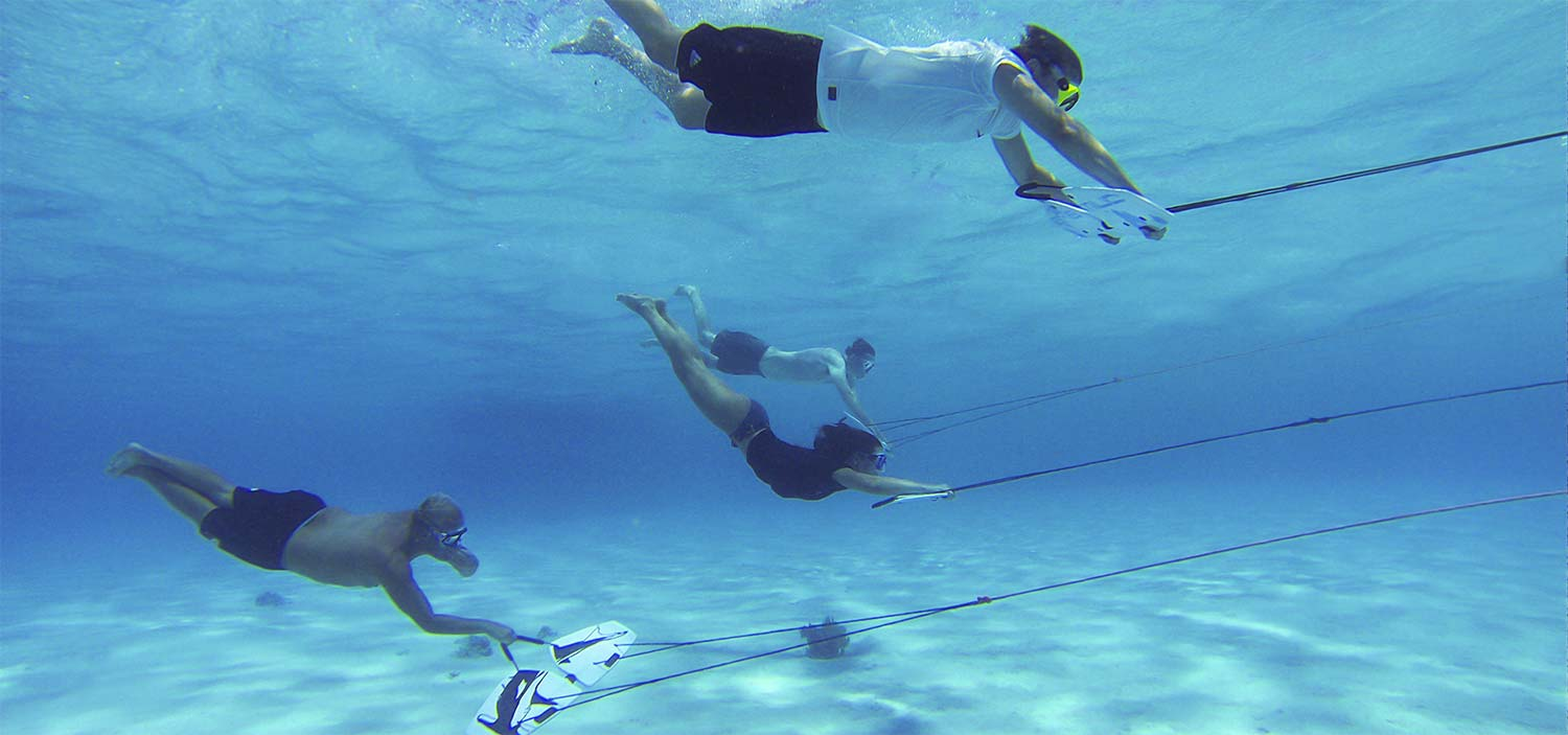 multiple riders subwinging under water