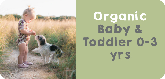 Baby in field wearing Organic Cotton Baby Body