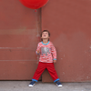 Image of boy wearing red striped childrens organic tshirt with elephant picture