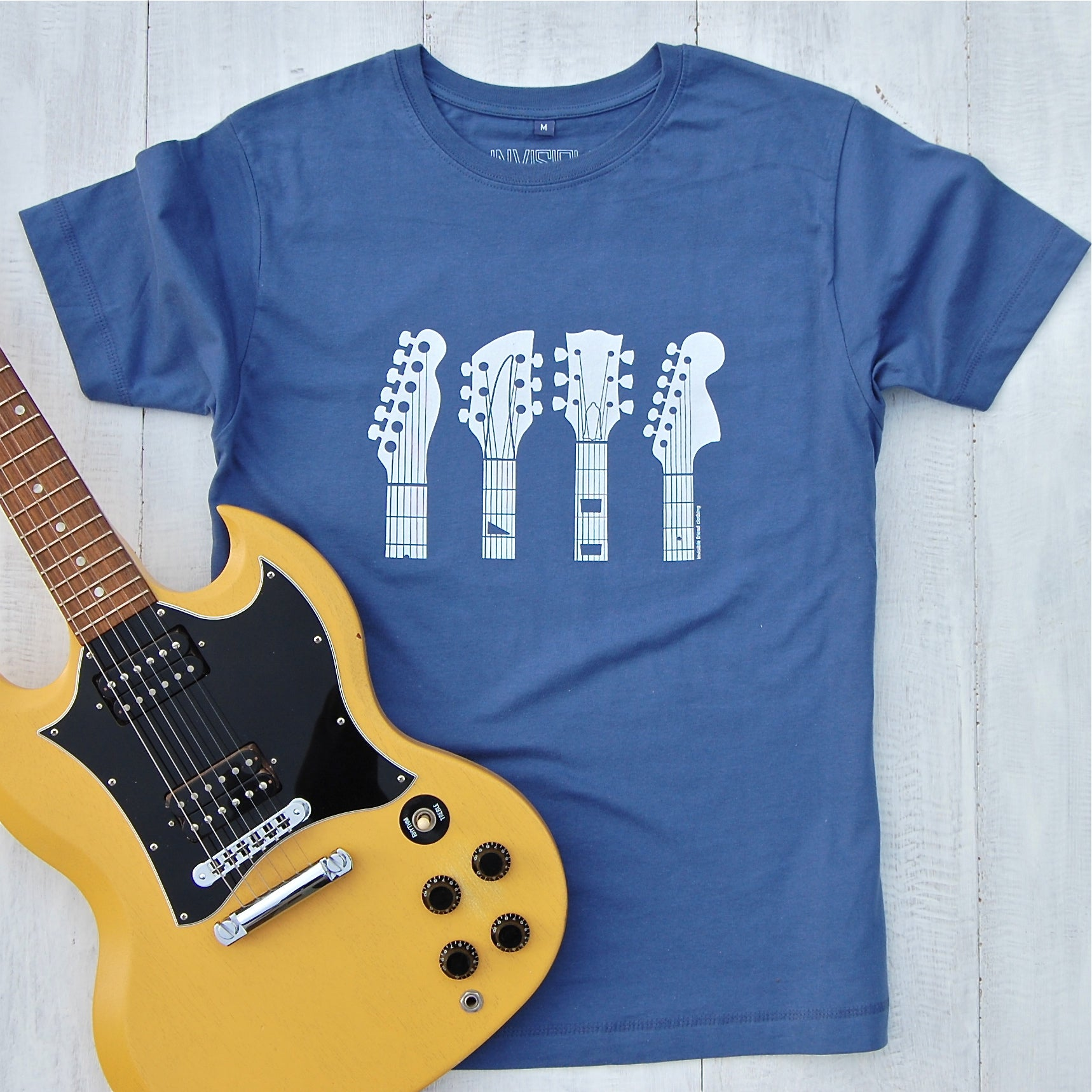 blue t-shirt with guitar headstocks design