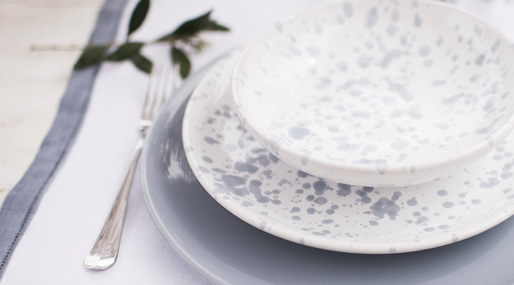 white ceramic dinnerware set with blue drops made in apulia