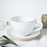 handmade in Italy white rustic ceramic cup and saucer from Apulia Grottaglie Fasano