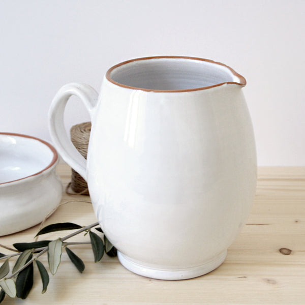 handmade in Italy white rustic ceramic curved jug from Apulia Grottaglie Fasano