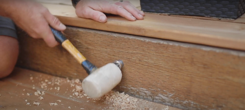 tapping light with rubber mallet