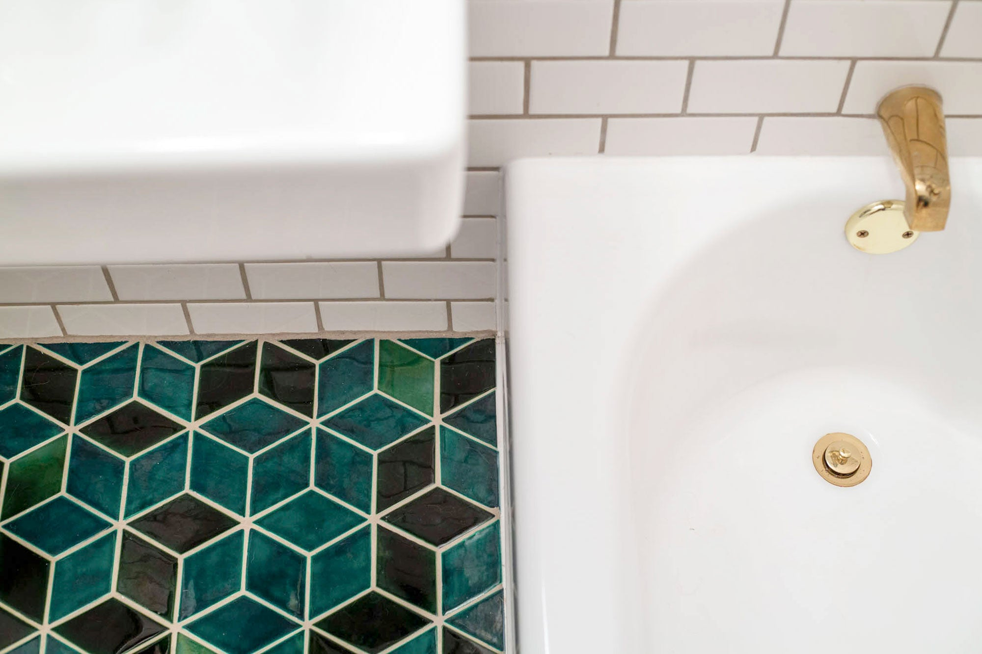 Green Tile Bathroom with Gold Accents