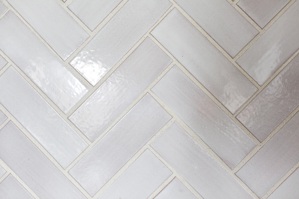 white herringbone kitchen tile backsplash