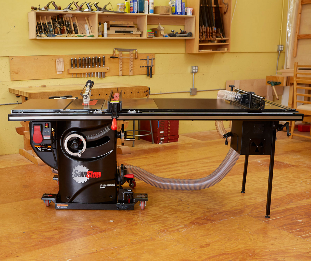 SawStop Professional Series with router table in woodshop with hardwood floors