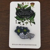 Skeleton holding Black Hellebore Enamel Pin